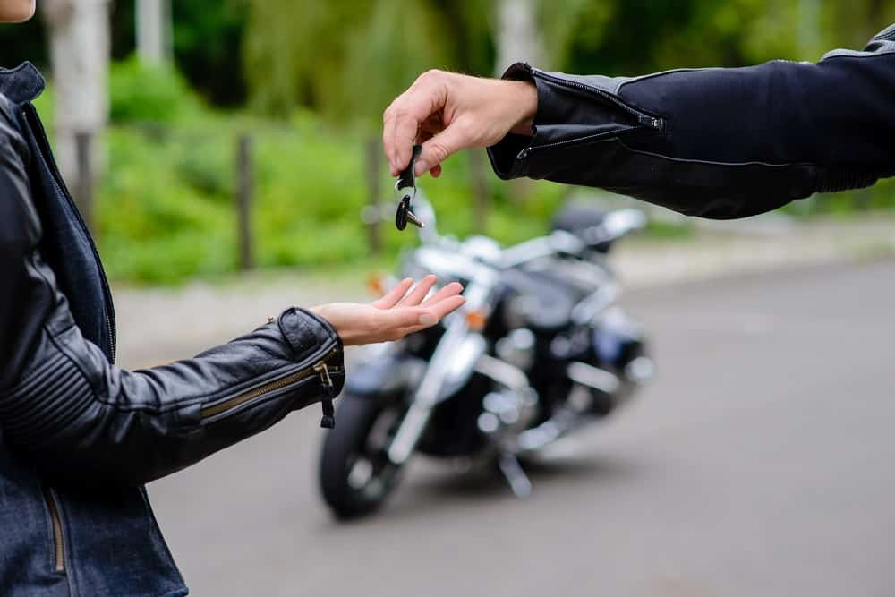 Hands give the keys