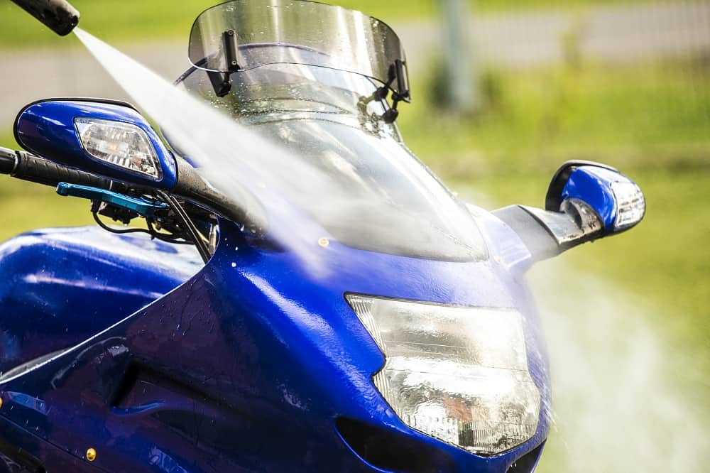 motorcycle windshield being cleaned