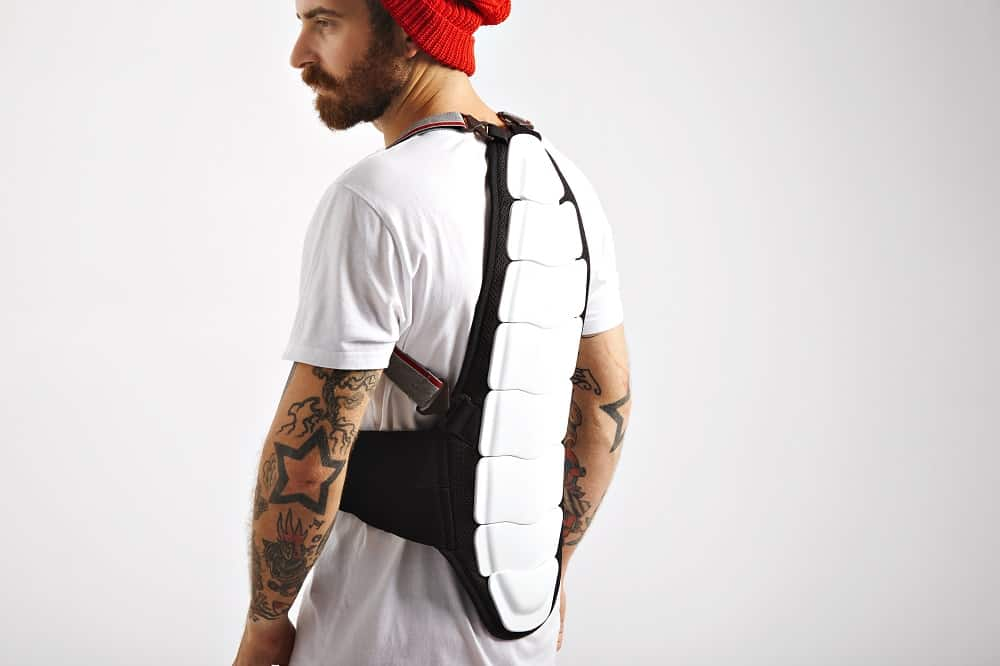 young man wearing back protection