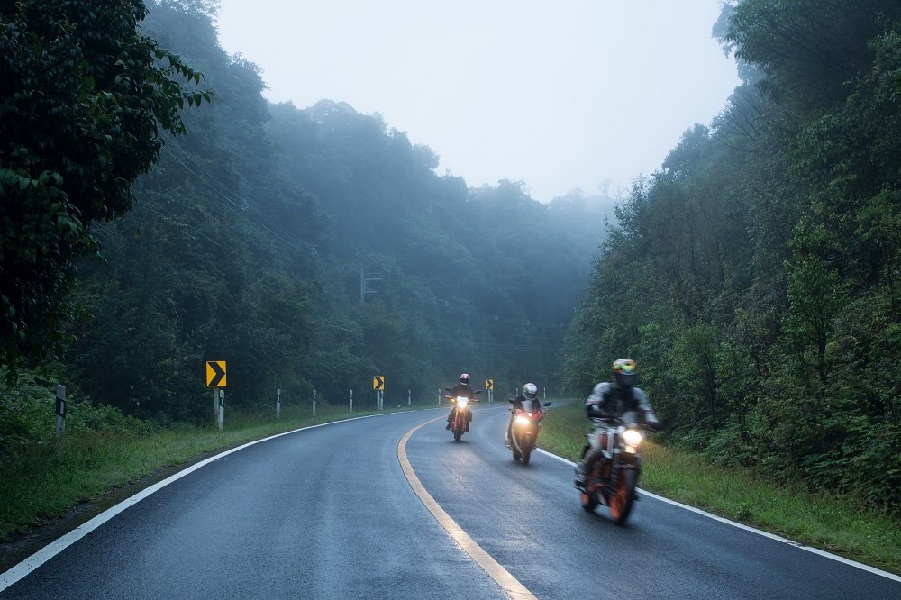 Motorcycle on foggy road